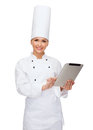 Smiling female chef with tablet pc computer Stock Image