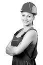 Smiling female construction worker isolated on white Royalty Free Stock Photo