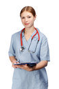 Smiling female doctor in blue surgical coat with red stethoscope Royalty Free Stock Photo