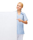 Smiling female doctor or nurse with blank board healthcare medicine advertisement and sale concept stethoscope and white Royalty Free Stock Photography