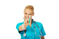 Smiling female doctor or nurse with stethoscope holding syringe Royalty Free Stock Photo