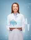 Smiling female doctor and tablet pc computer healthcare technology medicine concept Stock Photo