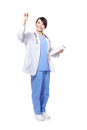 Smiling female doctor touching something Royalty Free Stock Images