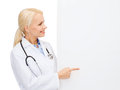 Smiling female doctor with white blank board Royalty Free Stock Photo