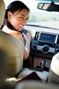 Smiling female driver looking over her shoulder Stock Images