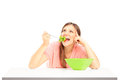 A smiling female eating salad Royalty Free Stock Image