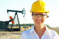 Smiling female engineer in an oilfield Stock Photo