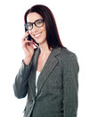 Smiling female executive talking on mobile Stock Image