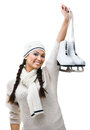 Smiling female figure skater hands skates Royalty Free Stock Images