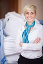 Smiling female housekeeper portrait of young with arms crossed Royalty Free Stock Image