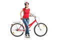 Smiling female posing next to a bicycle Royalty Free Stock Image