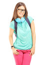 Smiling female with schoolbag and headphones looking at camera isolated on white background Royalty Free Stock Photo