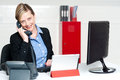 Smiling female secretary attending phone call Stock Photos