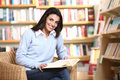 Smiling female student with book Royalty Free Stock Photo