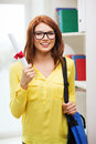 Smiling female student with laptop bag and diploma education concept redhead in eyeglasses Stock Photography