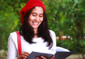 Smiling female student reading book asian woman standing on the park university Royalty Free Stock Photo