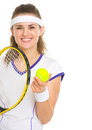 Smiling female tennis player with racket and ball Royalty Free Stock Photo