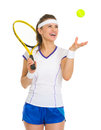 Smiling female tennis player throwing ball up Royalty Free Stock Photo