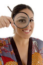 Smiling female watching through magnifying lens Royalty Free Stock Photo