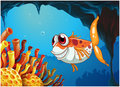 A smiling fish under the sea inside the cave illustration of Stock Image