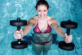Smiling fit woman doing aqua aerobics Royalty Free Stock Photo