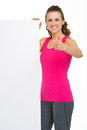 Smiling fitness woman showing blank billboard young and thumbs up Stock Photography