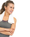 Smiling fitness young woman with towel looking on copy space isolated white Royalty Free Stock Photography