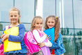 Smiling friends with backpacks going to school Stock Photos
