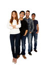 Smiling friends standing in a row full length portrait of Stock Photos