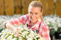 Smiling garden center woman potted daisy flowers Royalty Free Stock Photo