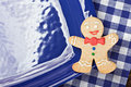 Smiling gingerbread man on a blue plate Royalty Free Stock Photos