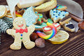 Smiling gingerbread man and christmas decorations for the holiday Stock Photography