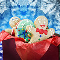 Smiling gingerbread man cookies and the rest in a gift box Stock Images