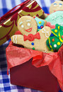 Smiling gingerbread man cookies and the rest in a gift box Royalty Free Stock Image