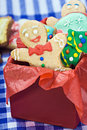 Smiling gingerbread man cookies and the rest in a gift box Stock Photo