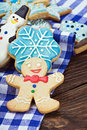 Smiling gingerbread men and christmas cookies Stock Photo