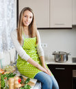 Smiling girl in apron at kitchen portrait of home Royalty Free Stock Photography