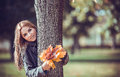 Smiling girl with autumn bouquet romantic in the park Stock Image