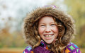 Smiling girl in an autumn park Stock Images