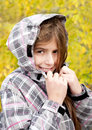 Smiling girl in autumn park season Royalty Free Stock Photos