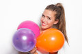 Smiling girl and balloons blonde with studio shot white background Stock Photo
