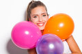 Smiling girl and balloons blonde with studio shot white background Royalty Free Stock Photo