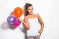 Smiling girl and balloons blonde with studio shot white background Stock Image