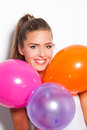 Smiling girl and balloons blonde with studio shot white background Stock Photos