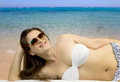 Smiling girl in beachwear relaxing to the beach girlwith sunglasses Royalty Free Stock Photo
