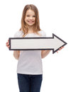 Smiling girl with blank arrow pointing right Royalty Free Stock Photo