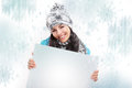 Smiling girl with a blank board and around snowing nice young show background Stock Images