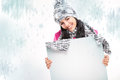 Smiling girl with a blank board and around snowing nice young snow background Royalty Free Stock Photos