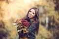 Smiling girl with bouquet in autumn park romantic the Royalty Free Stock Image