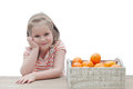 Smiling girl with a box of mandarins over white background Royalty Free Stock Photo
